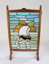 20th Century mahogany and leaded glazed firescreen, the leaded glazed panel depicting a ship, 43.5cm