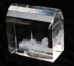 Clear glass paperweight, the interior depicting Notre Dame Cathedral, 8.5cm wide