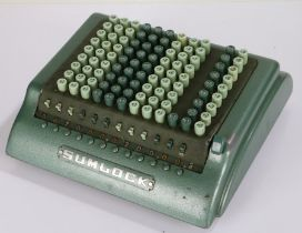 Sumlock adding machine, by Bell Punch Co. Ltd., with dust cover
