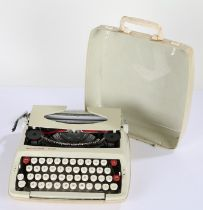 Smith-Corona De Luxe portable typewriter, housed in a plastic carrying case
