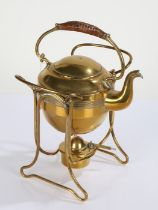Arts and Crafts design Bavarian brass spirit kettle on stand, having wicker carrying handle, the