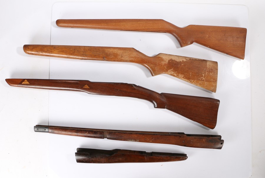 Selection of wooden rifle stocks, (5)