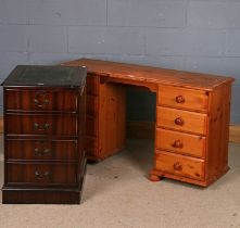 Pine desk, the rectangular top above eight graduated drawers, raised on bun feet, 126cm wide,