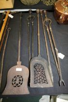 Pair of steel fire irons, painted in black, and three other steel fire irons (5)