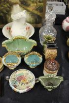 Mixed ceramics and glass to include, two decanters, one of bell shape and the other with grape and