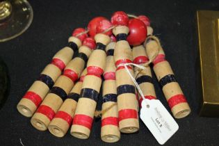 Children wooden skittle set, painted in red and navy, the skittles 14cm