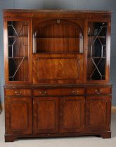 Large mahogany effect cabinet, the top flanked with glazed doors either side and centred with a drop
