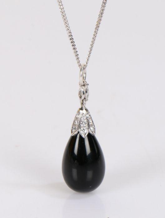 9 carat white gold, jet and diamond pendant necklace, the teardrop form jet bead in a diamond set