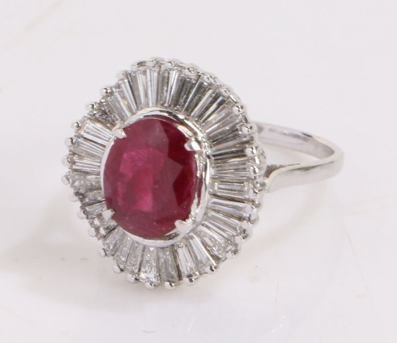 Ruby and diamond set ring, the central ruby at 1.79 carats and an undulating baguette diamond set