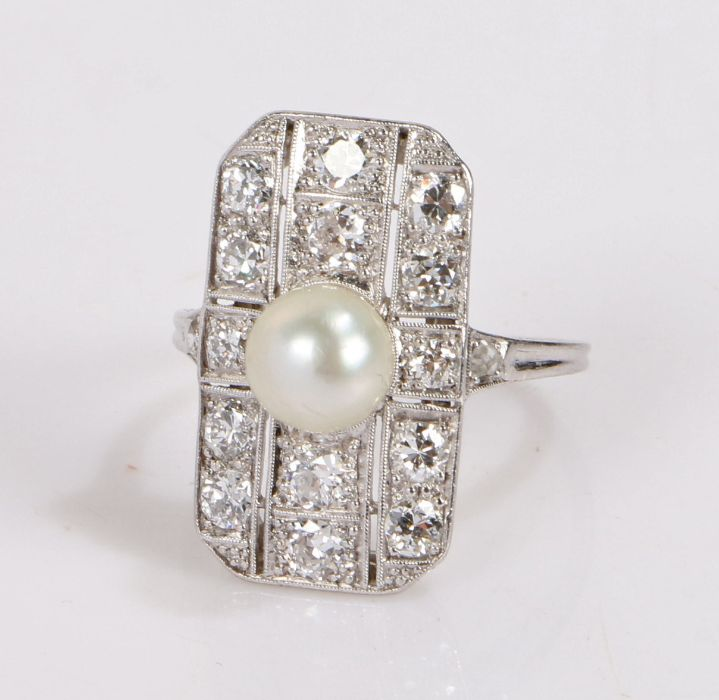Natural pearl and diamond set ring, the central saltwater pearl with no indications of heating set