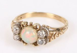 19th Century opal and diamond set ring, the central opal flanked by rose cut diamonds, ring size