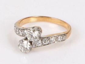 Portuguese 800 gold and diamond crossover ring, the two central diamonds flanked by four diamonds to