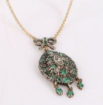 Emerald and diamond set pendant, the tied ribbon pediment above an oval body set with emeralds and