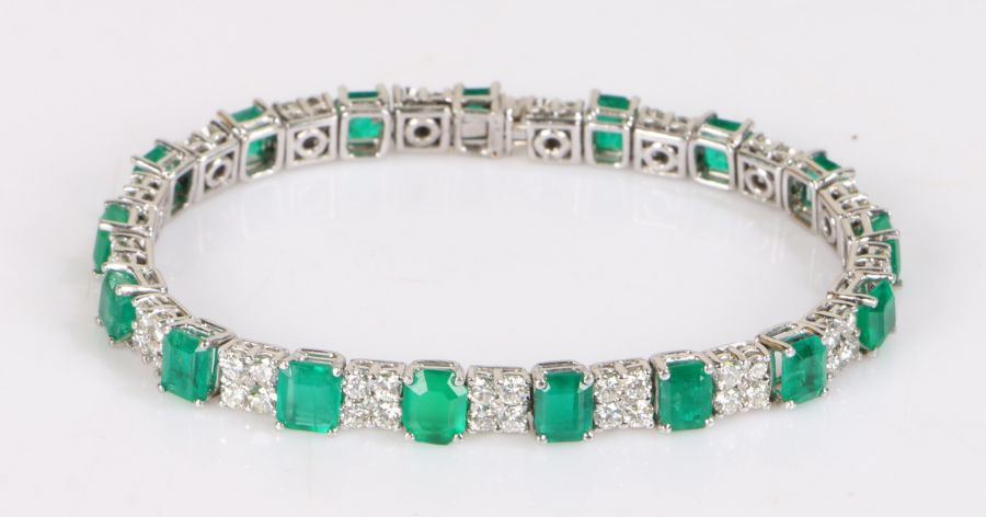 Emerald and diamond bracelet, the seventeen square emeralds interspersed with groups of four