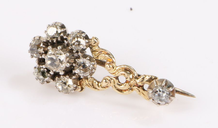 Gold and diamond set comet brooch, with arrangement of seven diamonds and central pierced scroll