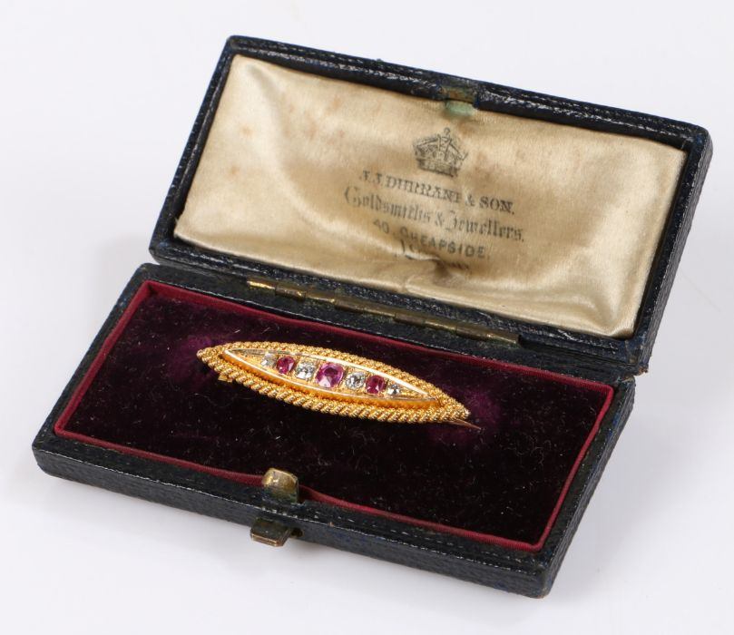 Victorian diamond and ruby brooch, with four round cut diamonds at an estimated 0.25 carats and