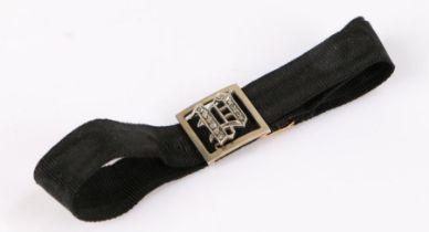 9 carat gold and diamond bracelet, the black fabric bracelet with gold clasp and diamond set panel