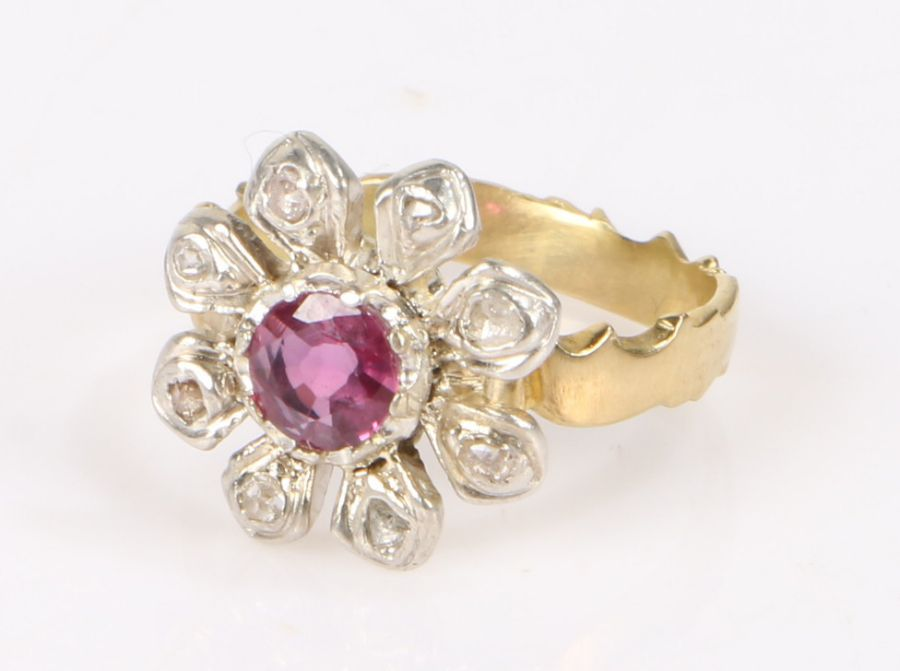 Ruby and diamond ring, the flower form head with central 0.47ct ruby surrounded by eight diamond set