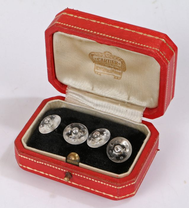 Cartier Paris, a pair of rock crystal and diamond set cufflinks, the diamond set to the head of each