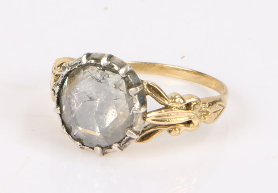 Diamond and gold ring, the central 1.68ct diamond flanked by pierced shoulders, ring size M, 4.5g
