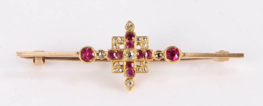 Diamond and ruby set brooch, with round cut rubies and diamonds set to the bar brooch, 50mm long
