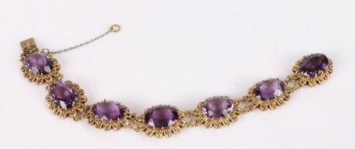 Gold bracelet set with seven facet cut amethysts, 20cm long, 42.4g