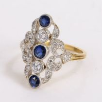 Diamond and sapphire set ring, with three round cut diamonds and a diamond surround at an