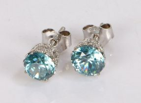 Pair of zircon and diamond ear studs, the pins set with a central zircon and pierced diamond set