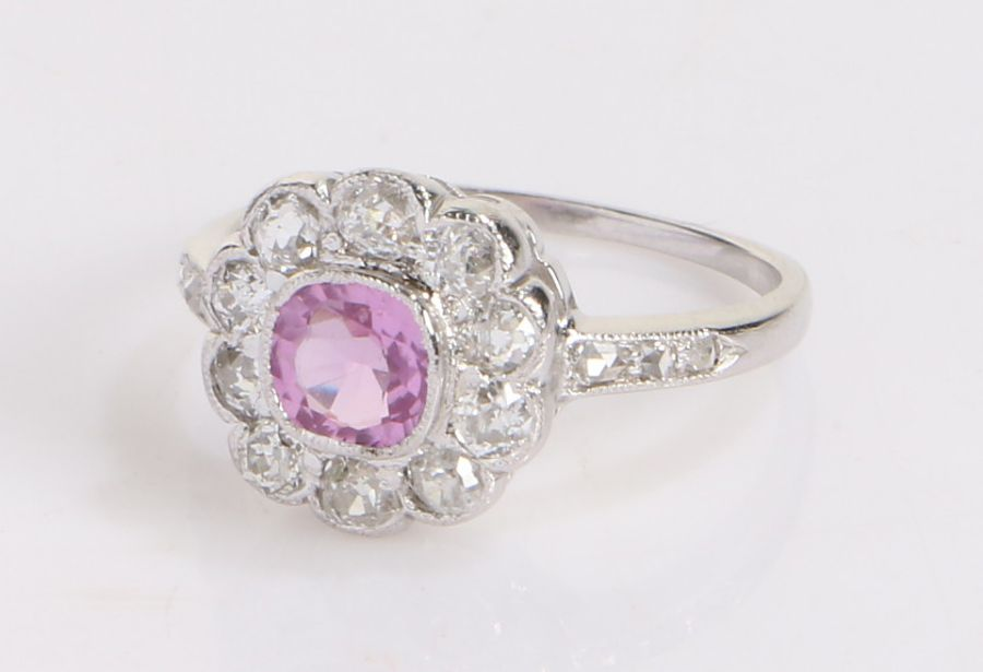 Pink sapphire and diamond set ring, the central pink sapphire at an estimated 0.68 carat and a