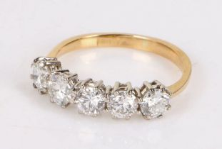 18 carat gold diamond set ring, with a row of five round cut diamonds totallign an estimated 1.55