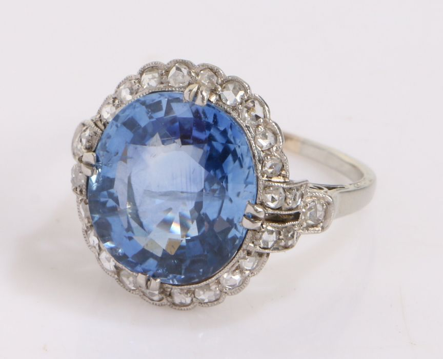 Fine and impressive sapphire and diamond set ring, the central sapphire at an estimated 9.63