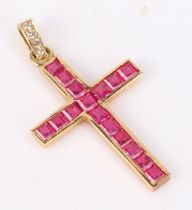 Gold ruby and diamond set cross pendant, the cross set with seventeen square cut rubies, with four