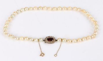 Pearl necklace, with garnet and pearl set clasp, 43cm long, 29.6g