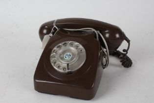 Brown plastic rotary dial telephone, 24cm wide