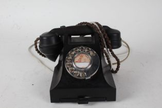 Black bakelite rotary dial telephone, with pull out tray