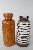 Two west German vases one of dark stripe colourings the other of orange and a onion like design 41cm