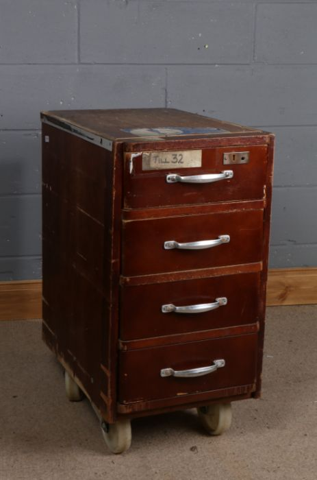 Set of portable bank drawers/till, fitted with four drawers and raised on four large wheels, 43cm