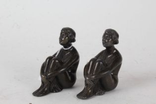 Pair of Art Deco spelter figures, each in the form of a seated lady, with registration marks, each