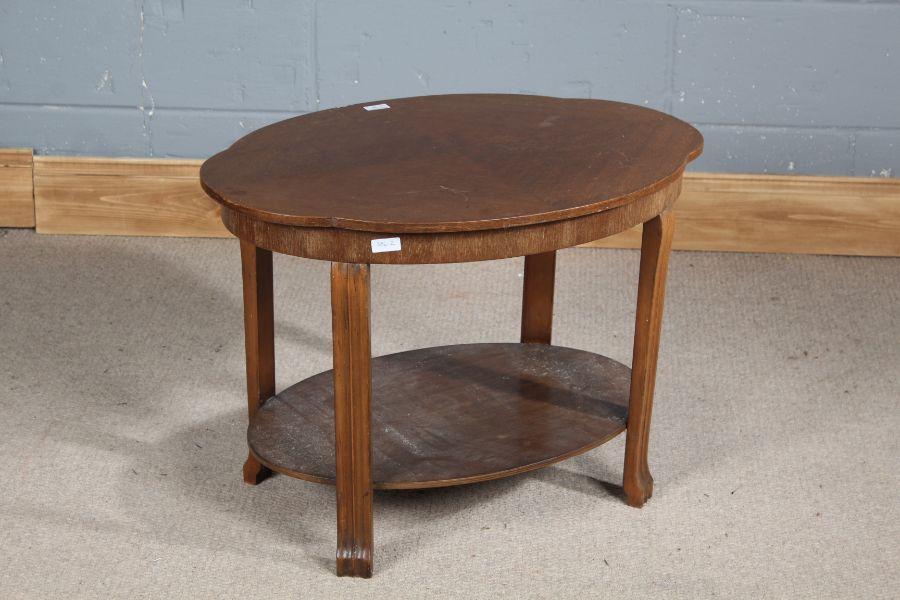 Art Deco walnut two tier table, having quarter veneered shaped top, 70.5cm wide x 50.5cm high
