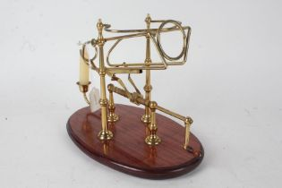 20th century brass and mahogany decanter stand, with candle sconce, 33cm wide