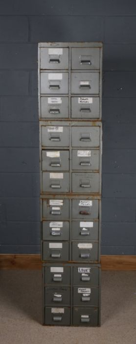 Four stackable banks of metal drawers, each bank fitted with six drawers, 194.5cm high when