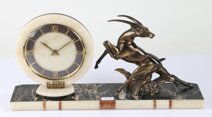 Art Deco style mantel clock, the dial with a white onyx surround and Roman numerals, flanked by a