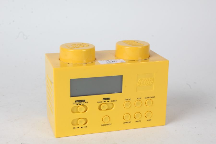 Lego portable clock radio, in the form of a yellow brick, with charger, 16cm wide and 11.5cm high
