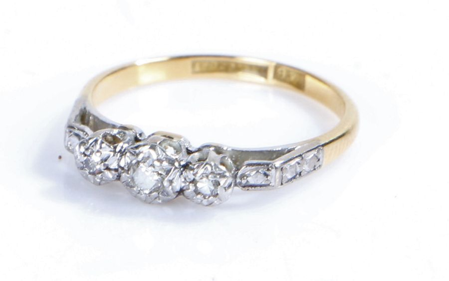 18 carat gold ring, with three platinum set diamond chips, ring size L, 2.4g
