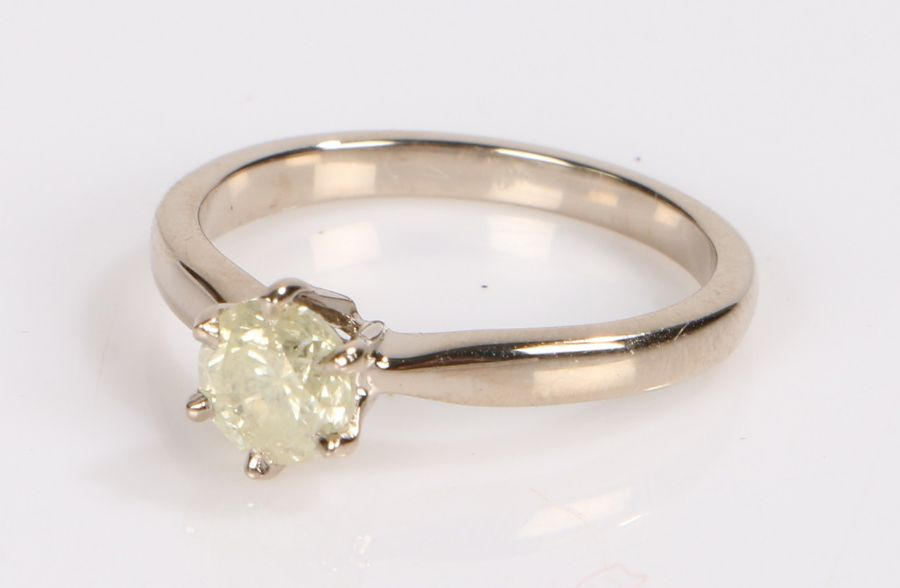 18 carat white gold and diamond set ring, the round brilliant cut diamond at 0.84 carats in light