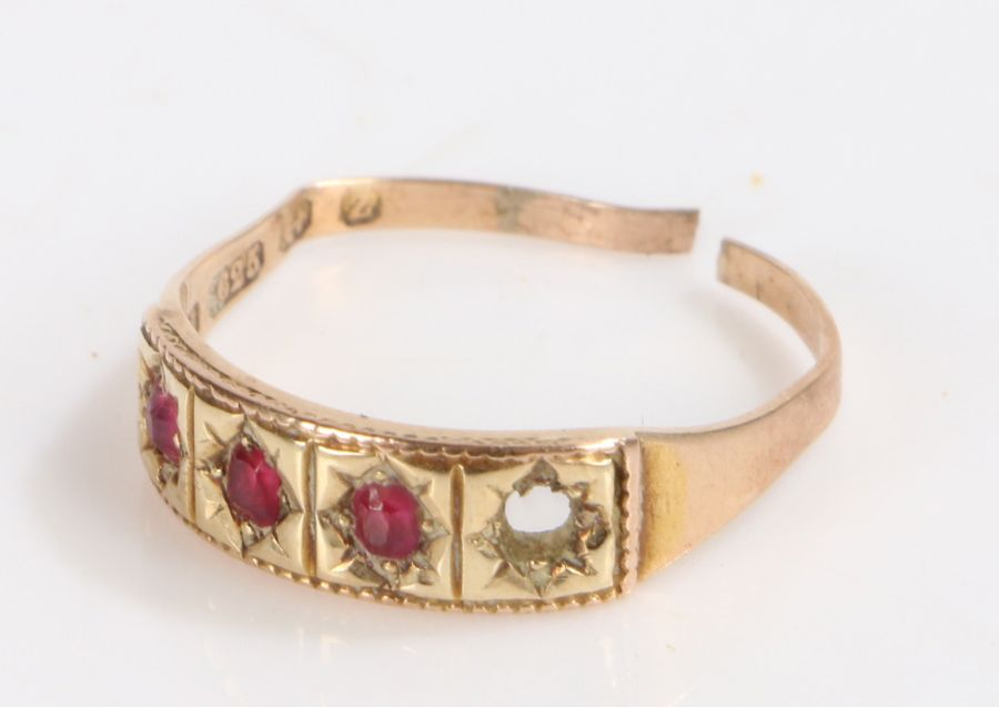 15 Carat Gold ring, with three rubies (one stone missing), gross weight 2.2g
