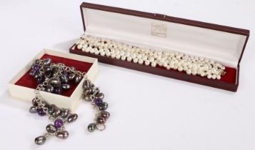 Set of simulated pearls together with an necklace