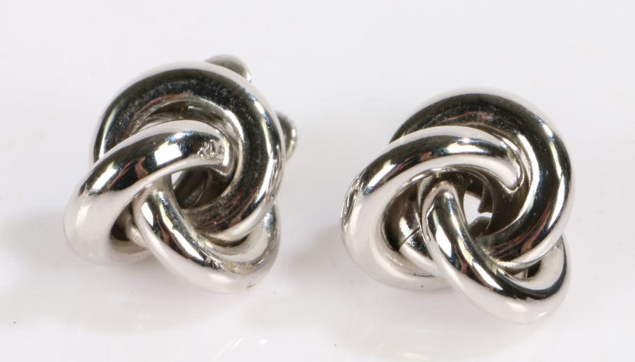 Pair of Napier white metal earrings, (2)