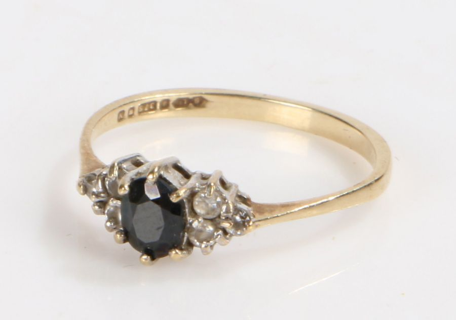 9 Carat gold and sapphire ring, ring size, gross weight 1.1 grams