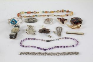 Collection of costume jewellrey to include brooches, necklaces, and a watch (Qty)